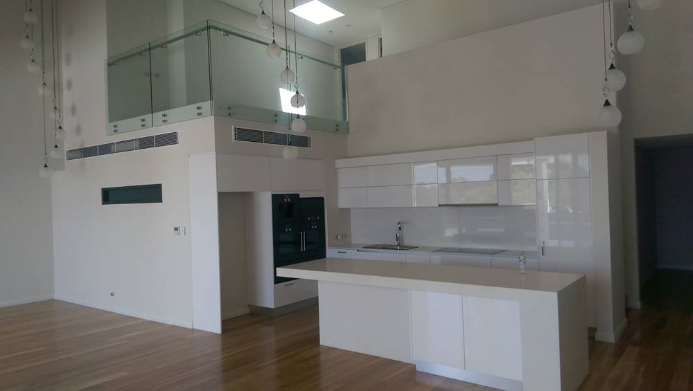 perth commercial development installs glass balustrades