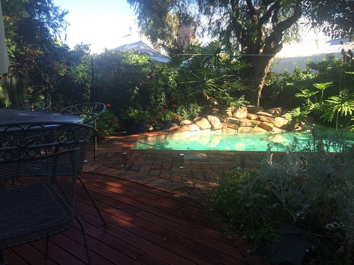 pool fence installation in a garden pool